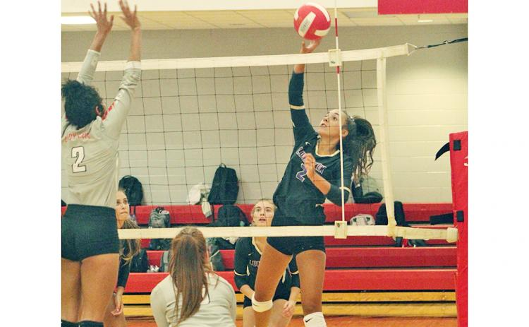 Isabel Davenport gets the upper hand with a deft touch at the net for a Lumpkin point versus Rabun. Davenport has upped her aggressiveness this season and continues, alongside Kiersta Trammell as part of Lumpkin's setting dynamic duo.