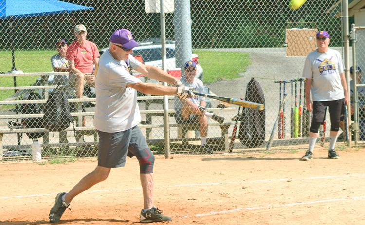 "Dahlonega Gold player Jeff ""Make My Day"" Maynard smacks a double during the Gold's league matchup against the LC Miners."