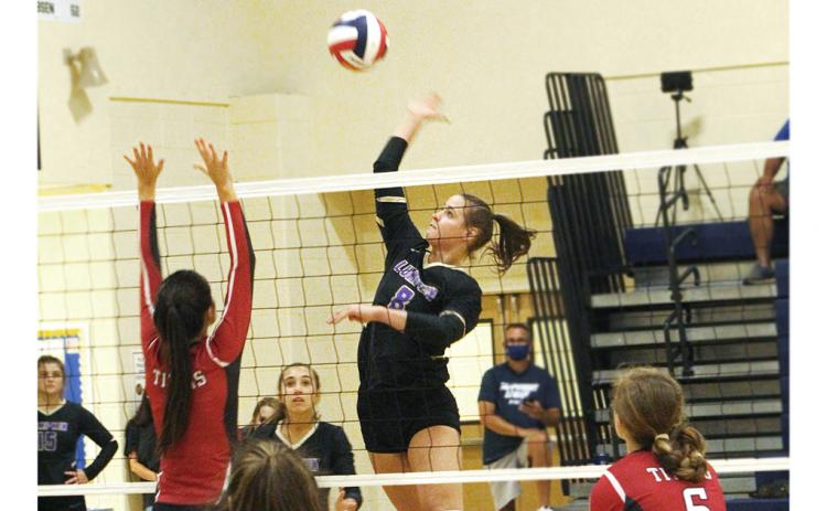 Lady Indians player Makenzie Caldwell records a kill against North Oconee. Caldwell was instrumental in Lumpkin's victory over North Oconee last week and in the team's historic 12-1 start to the 2020 season.