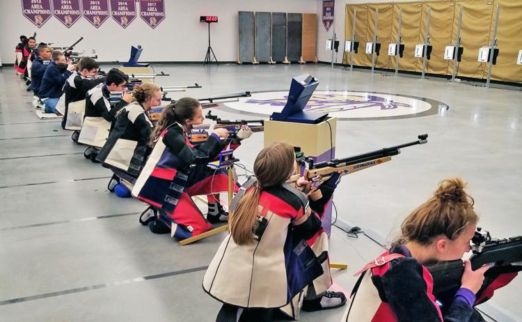 Members of the Lumpkin rifle team take to the Hunting Grounds rifle range at LCHS during the team's season opening victory over the Gainesville Red Elephants last week.
