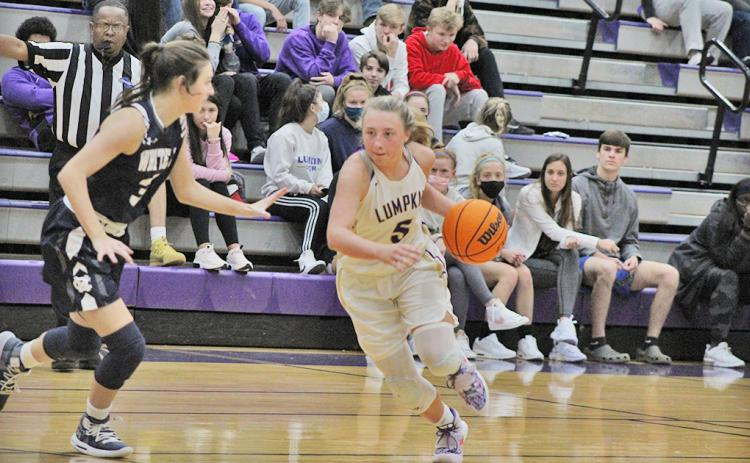 LCHS sophomore Lexi Pierce drives past a defender during Lumpkin's region game versus White County last Tuesday. The Indians' one-point overtime loss was their first region loss of the season and only their fourth loss all together this season.