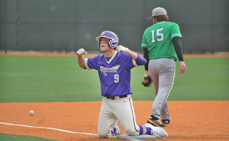 Hayden Cleland flexes for his teammates after sliding in safe for a RBI triple during Lumpkin's first game of the day against Pickens County. Cleland performed well both on the mound and at the plate.